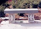 garden bench with fish carvings