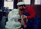 Wayne D. Ferree and a carved limestone gargoyle