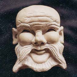 Carved Oriental Face